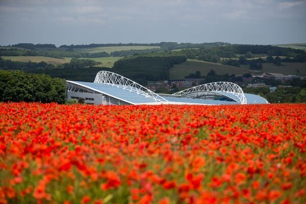 Image of the American Express Community Stadium against a backdrop of a poppy field, Brighton, Monday 5th July 2013