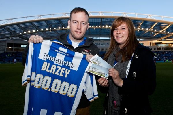 Craig Blazey with his sister celebrating being the 500000 fan through the Amex turnstiles during Brighton & Hove Albion v Reading, nPower Championship, Amex Stadium, Brighton, Tues 10th April 2012