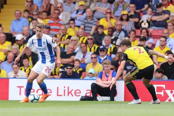 Brighton and Hove Albion midfielder Solly March (20) take on Daryl Janmaat. Match action during the Premier League match between Watford and Brighton and Hove Albion at Vicarage Road, Watford on the 11th August 2018