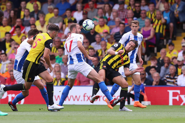 Brighton and Hove Albion striker Glenn Murray (17) & Daryl Janmaat. Match action during the Premier League match between Watford and Brighton and Hove Albion at Vicarage Road, Watford on the 11th August 2018