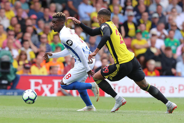 Brighton and Hove Albion midfielder Yves Bissouma (8) gets the better of Etienne Capoue. Match action during the Premier League match between Watford and Brighton and Hove Albion at Vicarage Road, Watford on the 11th August 2018