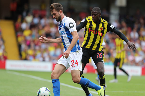 Brighton and Hove Albion midfielder Davy Propper (24) & Abdoulaye Doucoure. Match action during the Premier League match between Watford and Brighton and Hove Albion at Vicarage Road, Watford on the 11th August 2018