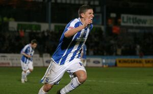 Alex Revell celebrates his goal against Stafford Rangers