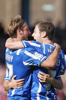 Ashley Barnes and Glenn Murray celebrate