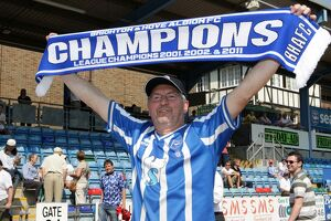 A fan celebrates our League 1 success in 2011