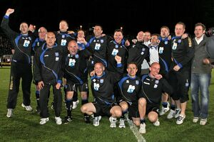 Gus and his backroom staff celebrate promotion to The Championship in 2011