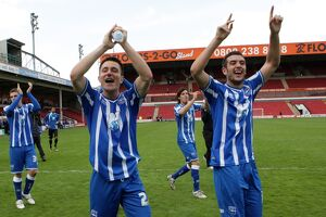 The players celebrate winning the League 1 title away at Walsall, April 2011